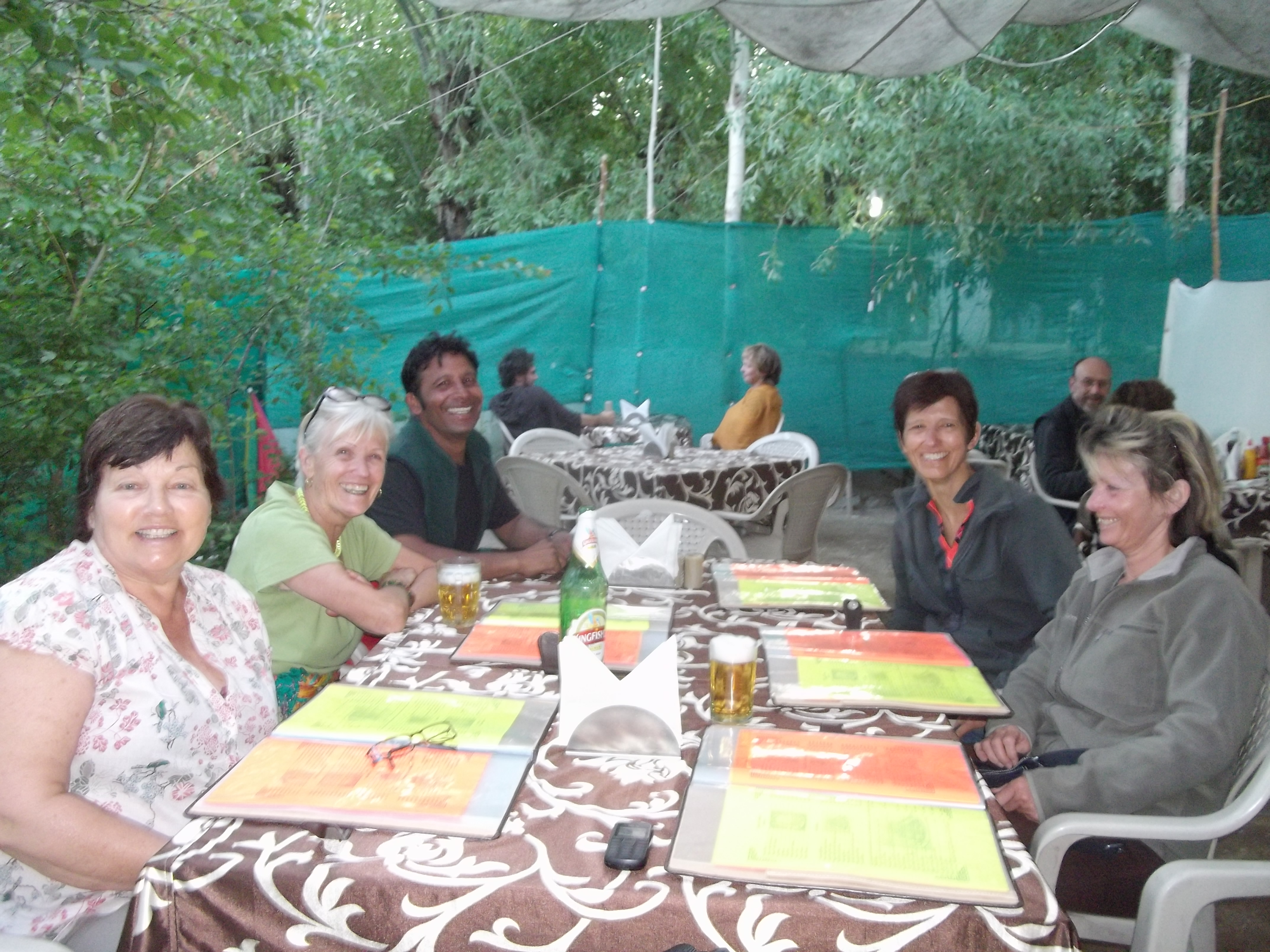 Atma having a meal with a group of trekkers