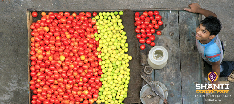 Vendeur de fruits en Inde