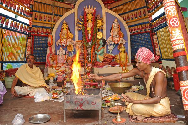 Kolkata - hindu priests chants prayer on the day of Mahanavami of Durga Puja