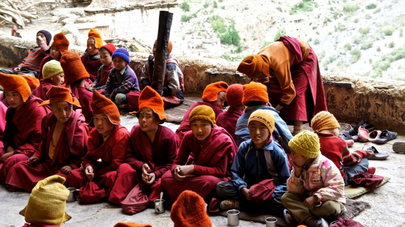 (Children monk waiting for tea to be served)